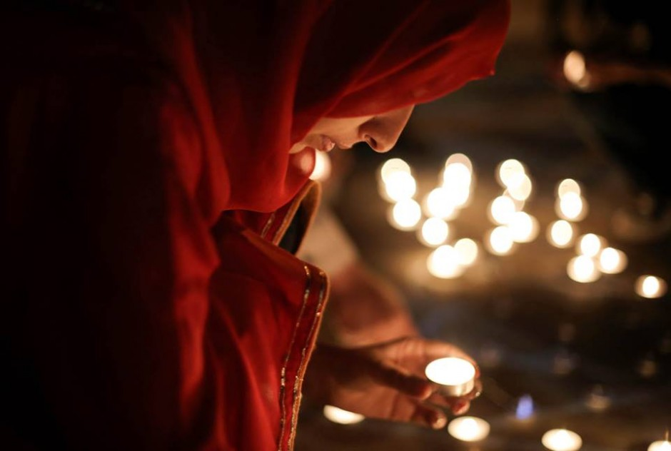 Woman at candlelight vigil.