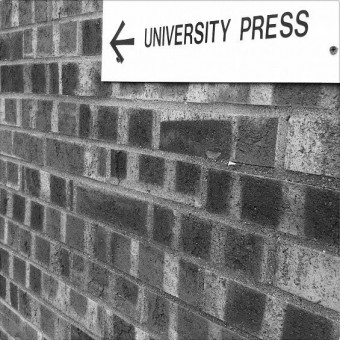 Wall with University Press sign