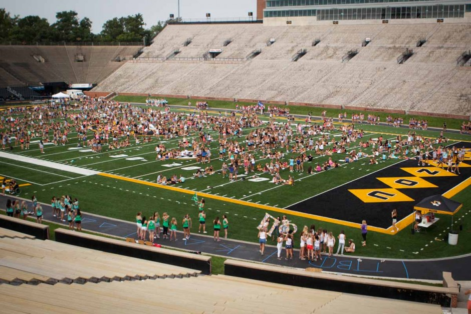 Students on the football field.
