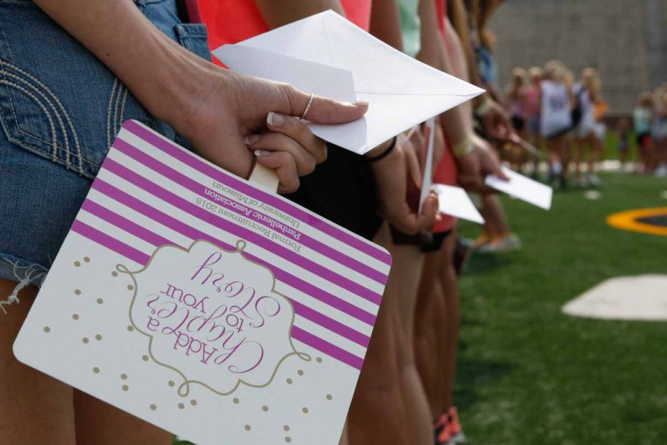 McKenna Alexander holds her bid day card, waiting patiently to open it and see which chapter is waiting to welcome her Sunday morning on Faurot field. Pi Chi leadership counted down from 10 to the reveal.