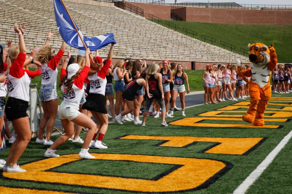 Truman the Tiger runs in front of sorority chapters gathered on the West side of Faurot Field Sunday morning. Many of the seniors pulled Truman aside for group photos and selfies.