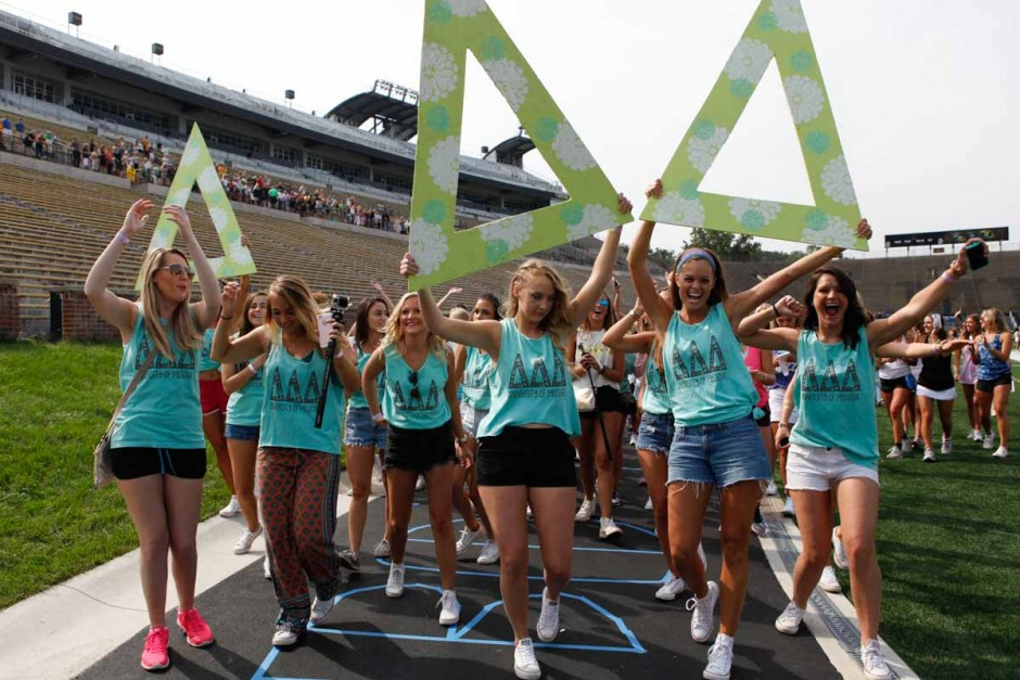 Delta Delta Delta starts their walk back to Greek town after being released from Faurot Field Sunday morning. All chapters had large, wooden letters decorated with their houses colors that members were able to pose with for photos.