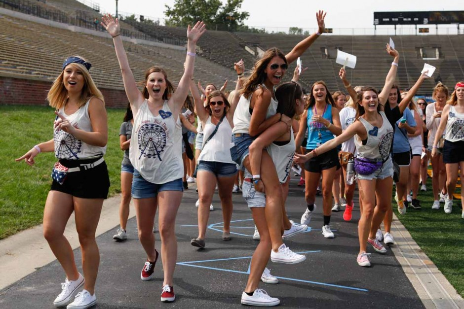 Members of Sigma Kappa jump and scream with excitement as they gather up their new members and head to exit Faurot Field Sunday morning. Bid Day's first year on Faurot proved to be more organized than previous years on the Quad.