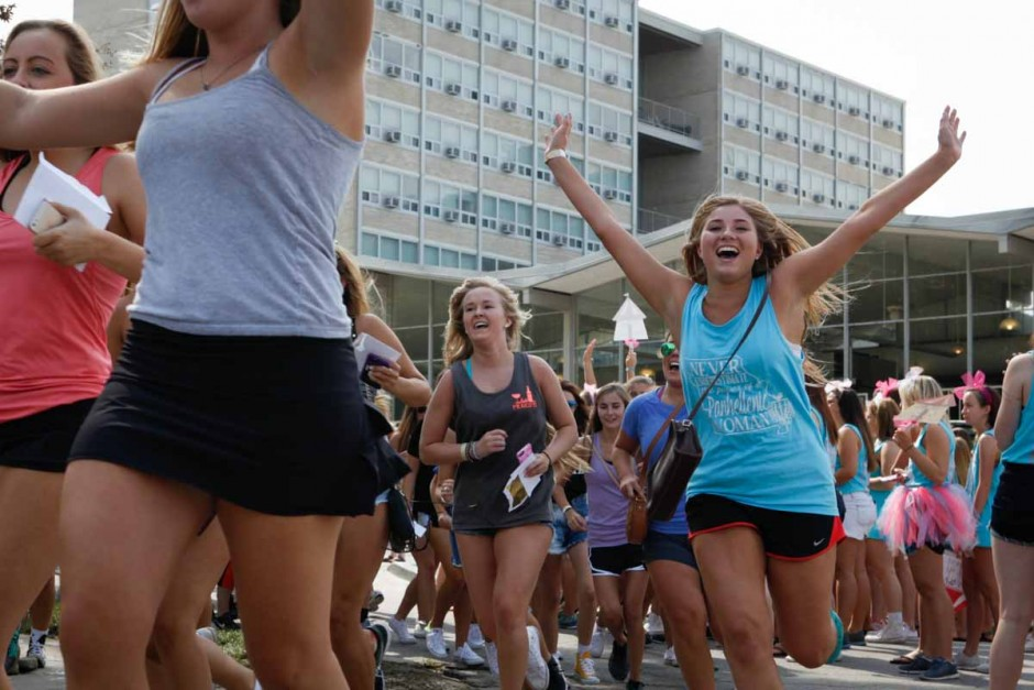 Freshman race into Greek town to meet up with their respective chapters after the Bid Day reveal on Faurot Field Sunday morning. Everyone was funnelled out of Faurot, under the tunnel and into Greektown, easing the flow of traffic.