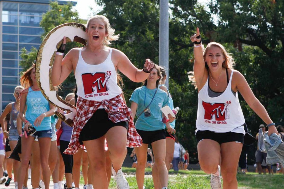 Alpha Chi Omega seniors lead their group of new recruits back to Greek town after the Bid Day reveal on Faurot Field Sunday morning.