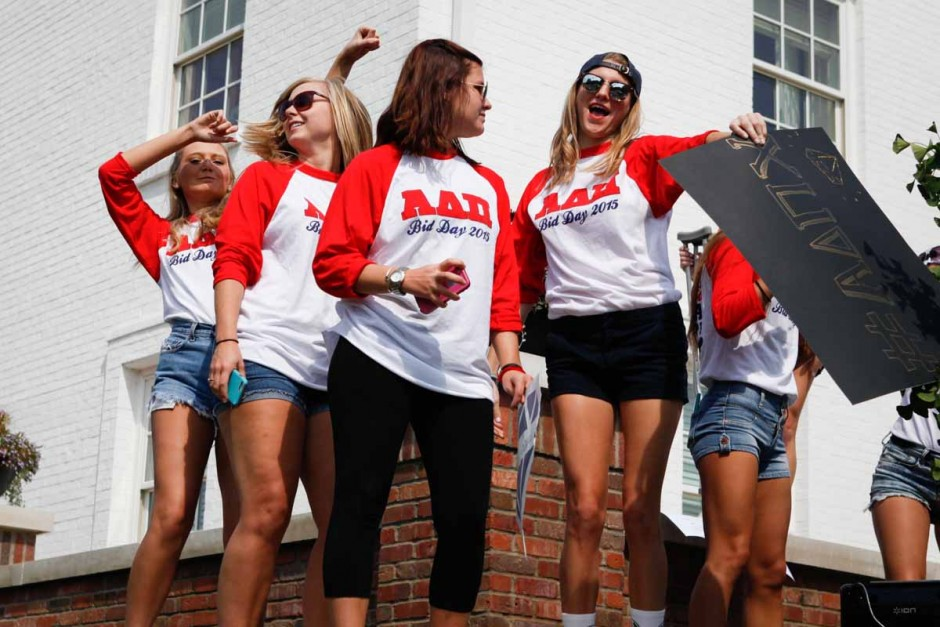 Members of Alpha Delta Pi dance on the southeast edge of their house as younger members welcome new freshman into their house.