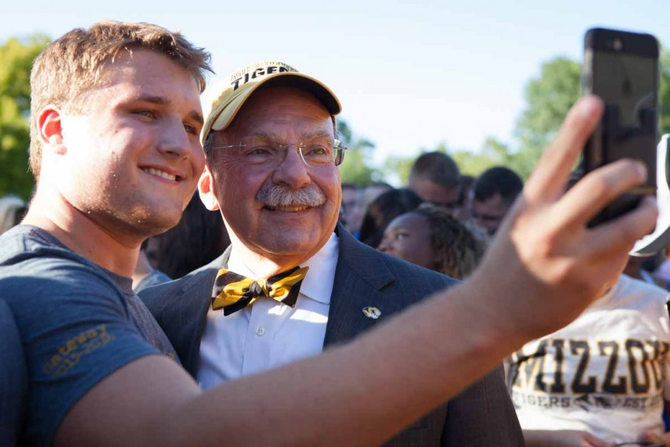 Brendan Kloeppel doesn't pass up the opportunity to get a selfie with Chancellor Loftin before the Tiger Walk on the Quad Sunday evening. The Chancellor walked among the freshman before the festivities began and stopped for conversation and selfies with the students. Photo by Tanzi Propst.
