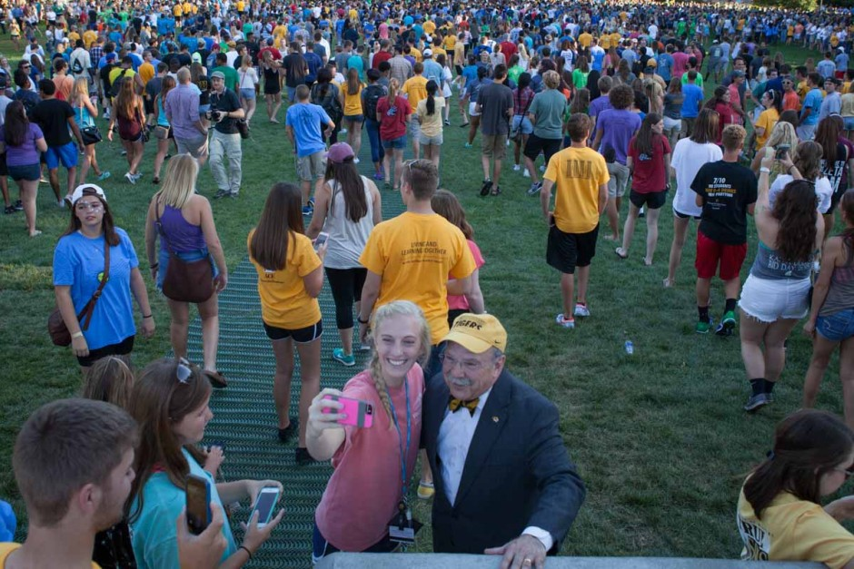 Many freshman had to stop for the infamous selfie with Chancellor Loftin before continuing on to receive free tiger stripe ice cream after the Tiger Walk Sunday evening. Once the first students raced through, the pace slowed considerably and gave others more time to spend chatting it up with Mr. Bow-Tieger. Photo by Tanzi Propst.
