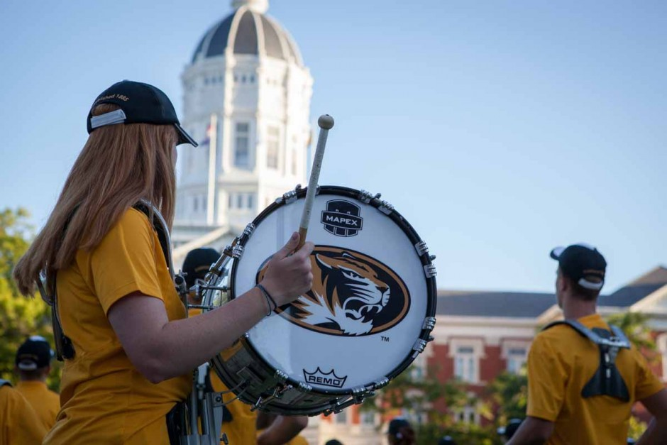 """A member of the Mizzou Drumline dances it out during Marching Mizzou's performance on the Quad Sunday evening. The band played a plethora of fan favorites including """"Hey Baby,"""" """"The Eye of the Tiger"""" and Mizzou's Alma Mater. Photo by Tanzi Propst."""