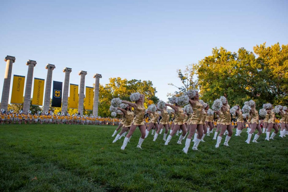 The Mizzou Golden Girls perform in front of Jesse Hall to a crowd of freshmen, parents and other Mizzou students as Marching Mizzou plays fan favorites in the background Sunday evening. This year marks the 50th anniversary of the Golden Girls at Mizzou. Photo by Tanzi Propst.