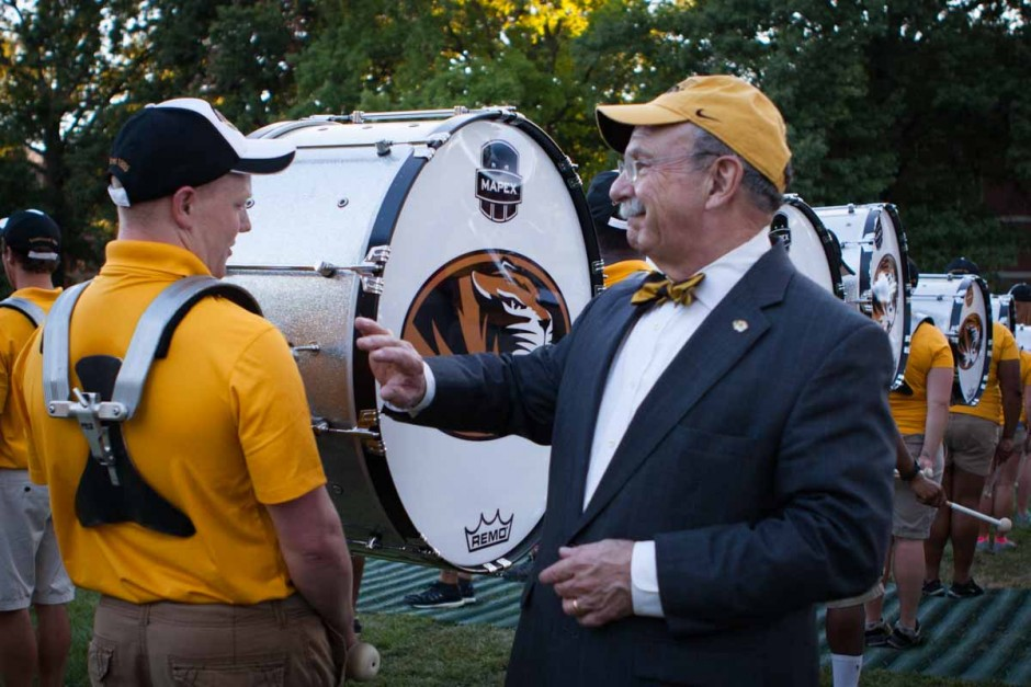 A member of the Mizzou Drumline takes a moment to greet Chancellor Loftin as he makes his way around the edge of the ensemble Sunday evening. Photo by Tanzi Propst.