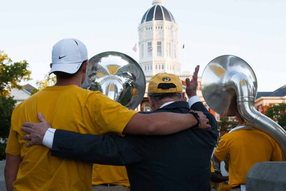 Chancellor Loftin sways with a student to Marching Mizzou's final song, Mizzou's Alma Mater. Photo by Tanzi Propst.