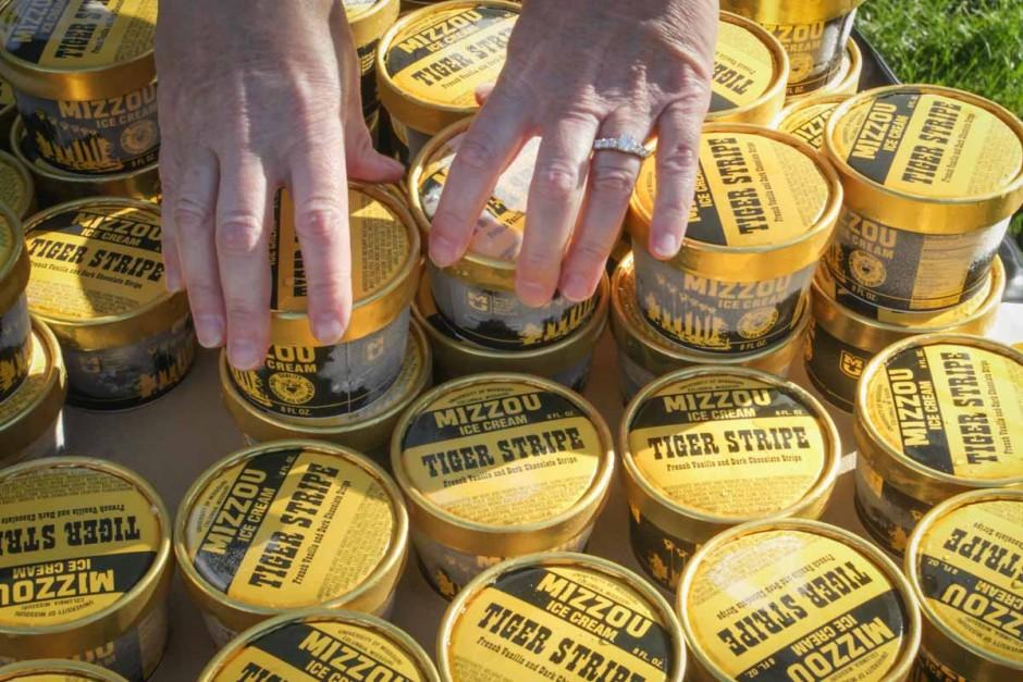 Volunteers stack Tiger Stripe ice cream in preparation for the swarm of Mizzou freshmen. Photo by Rob Hill.
