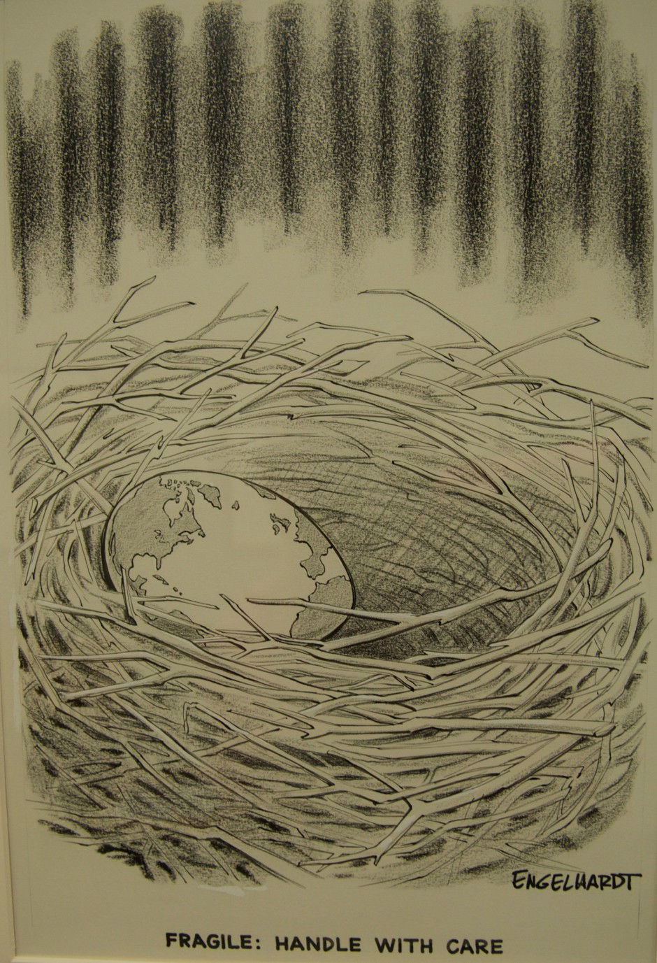 """A 1971 cartoon representing the earth as an egg in a bird's nest. The caption reads, """"Fragile: Handle with Care."""""""