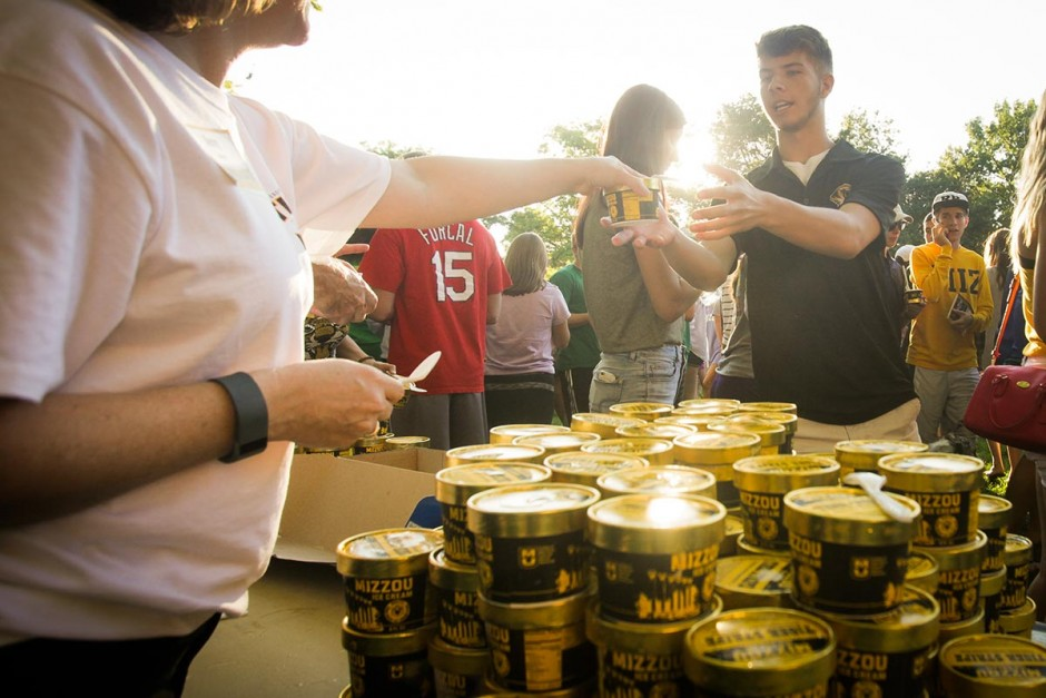 Students wait in line for a taste of Tiger Stripe ice cream to cool their engines after running across The Quad. Photo by Nic Benner.