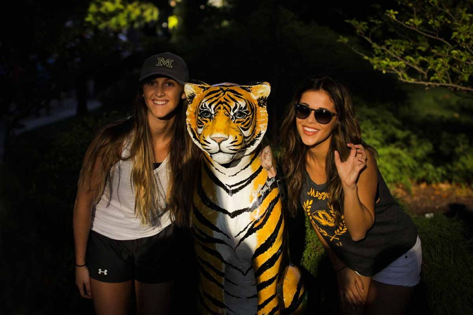 Freshman Jordan Alford and Sophomore Madeline Simer pose by a Tigers on the Prowl statue. Photo by Nic Benner.
