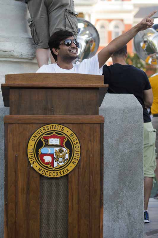 Graduate engineering student Thyinath Panduga, from India, pretends to give a speech from the event podium. Photo by Nic Benner.