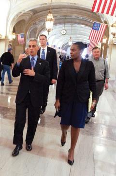 Tarah Cooper walking with Rahm Emmanuel.