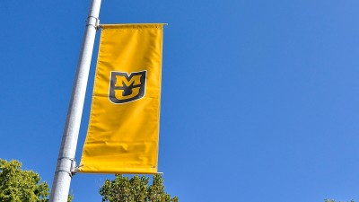 MU banners on a lamppost.