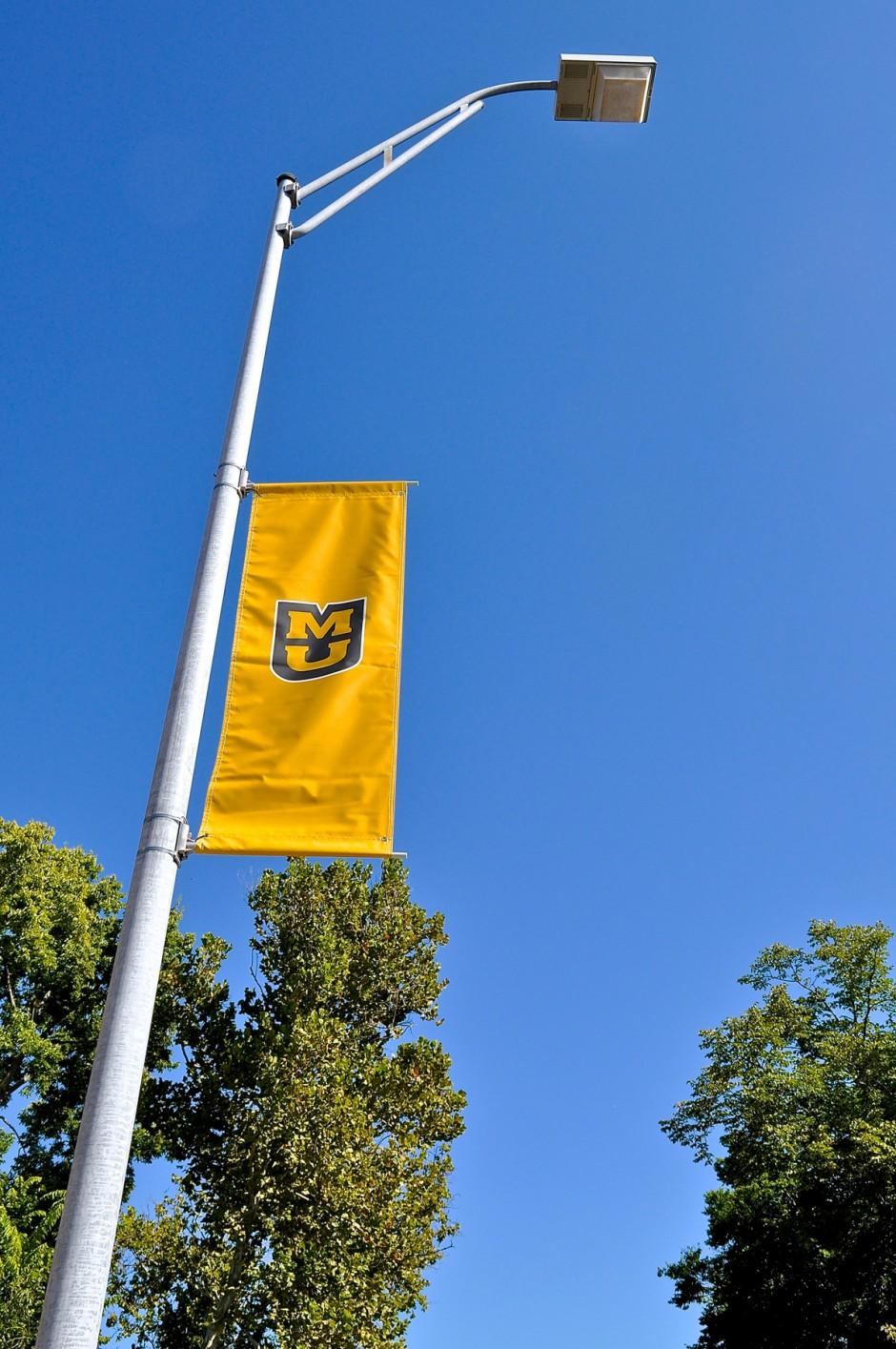 MU banners on a lamppost.