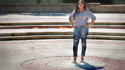Razia Hutchins standing in Speakers Circle.