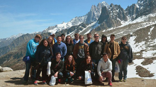 Students pose for a group photo in the French Alps.