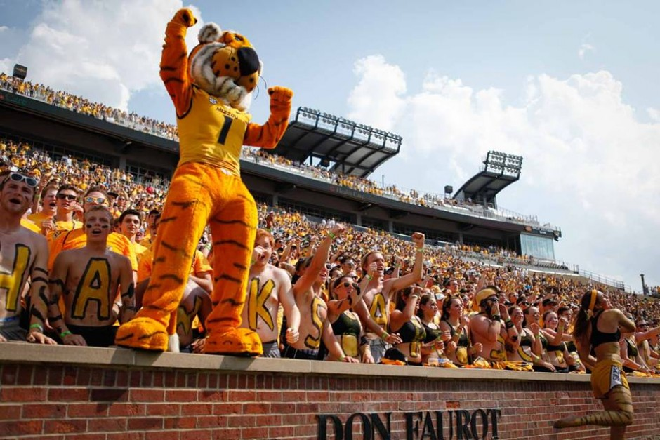 Truman the Tiger leads students in cheers in the Tigers Lair section of Memorial Staduim.