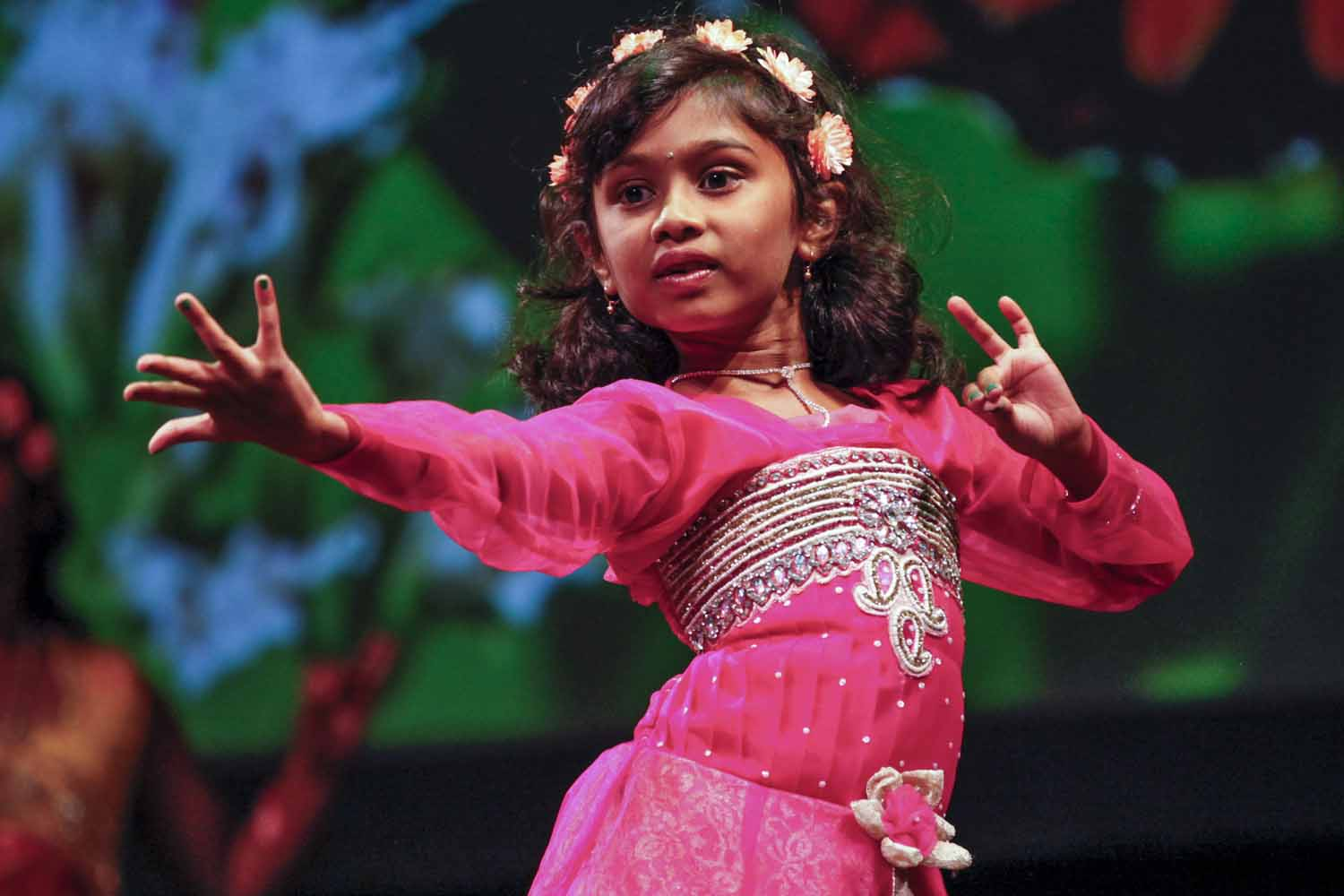 """A dancer performs """"Spring Blossoms"""" as the fourth act of the evening at India Nite in Jesse Hall."""