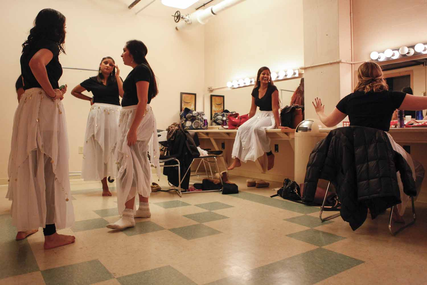 Members of Mizzou Masti converse with each other in the dressing room prior to their performance in India Nite at Jesse Hall.