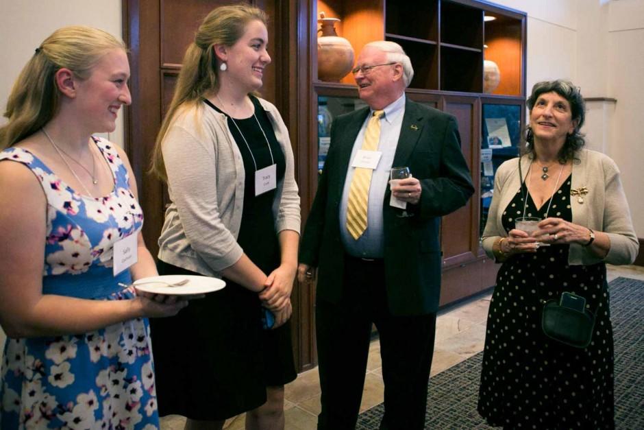 Copy editor Merrill Perlman and Professor Emeritus Brian Brooks mingle with students.