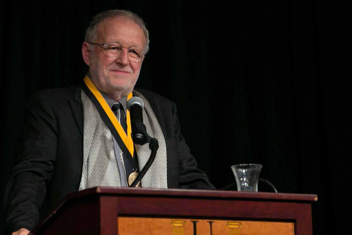 """Gerd Ludwig accepts his honor medal. Soon after leaving Germany and moving to New York in the mid-1980s, Ludwig started photographing for National Geographic magazine. His focus on environmental issues and the socioeconomic changes following the dissolution of the Soviet Union resulted in his book, """"Broken Empire: After the Fall of the USSR,"""" a 10-year retrospective published by National Geographic in 2001 in the U.S., Germany and Korea. Ludwig's ongoing coverage of post-Soviet Russia has garnered his distinction as the world's foremost color photographer documenting the region."""