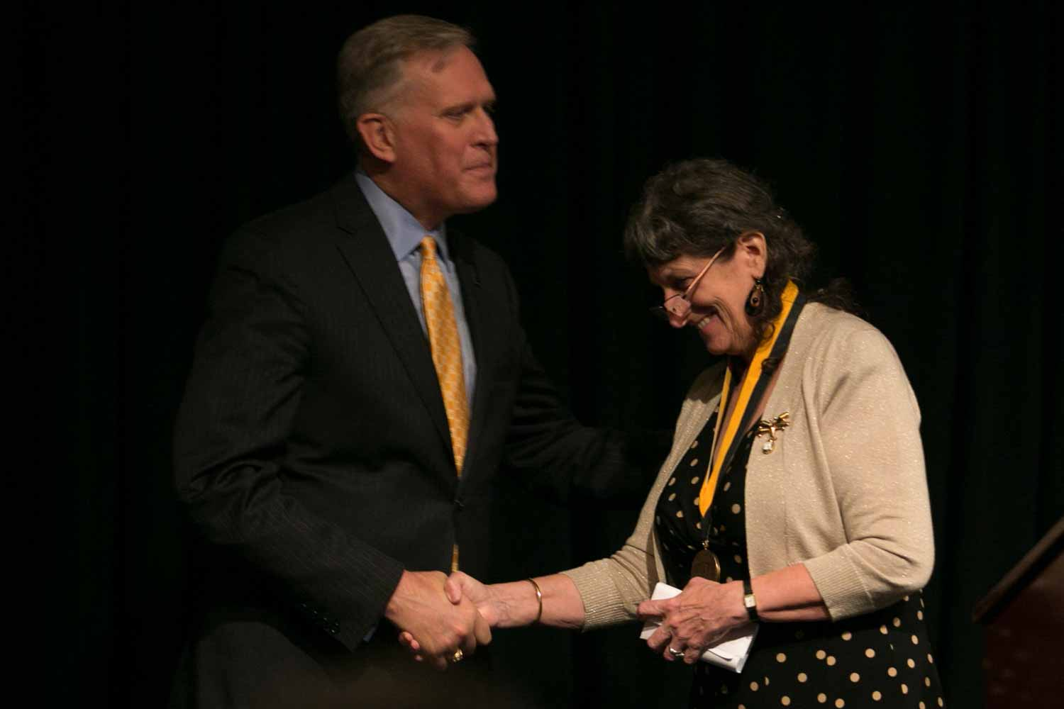 Merrill Perlman shakes Dean David Kurpius's hand after receiving her honor medal. In 1983, Perlman was hired as a Business copy editor at The New York Times, later becoming Metro copy desk chief (twice), night Metro editor, an editor on the Week in Review, recruiting editor for copy desks and managing editor of The New York Times News Service. In 2004, she was named director of copy desks, in charge of the 160-plus copy editors across the newsroom.