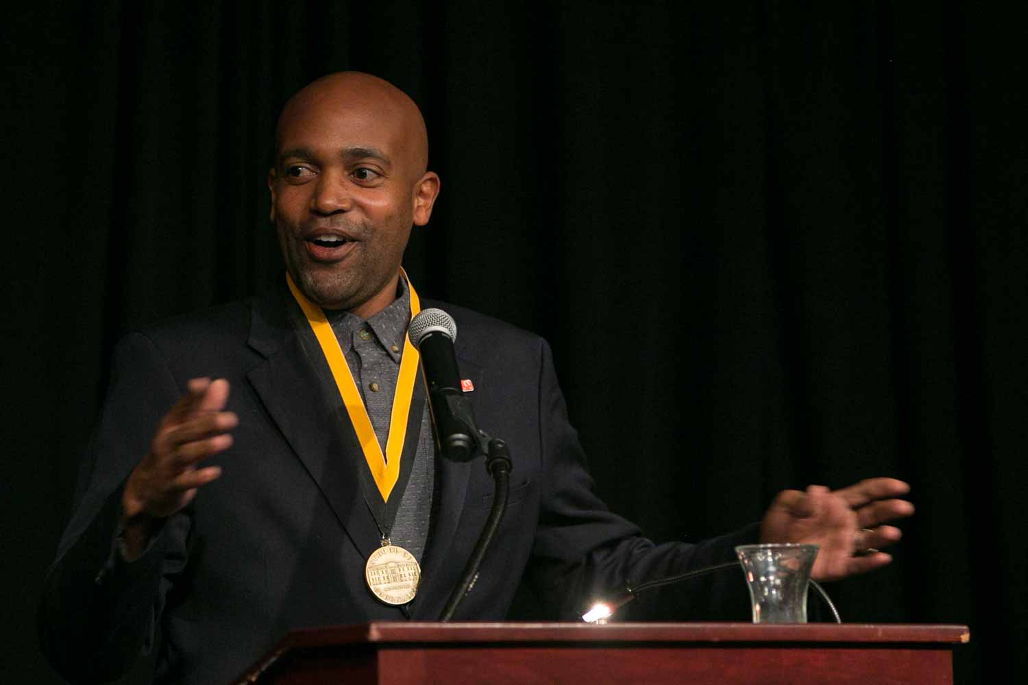"""Entrepreneur and activist Lincoln Stephens, BJ '03, delivers his acceptance speech after receiving an honor medal. In November 2008, Stephens decided to quit his job as an advertising account management executive to pursue his passion for mentorship and co-founded a nonprofit organization called The Marcus Graham Project. The organization, which is focused on bringing more diversity to the advertising industry through mentorship, exposure and career development, has been featured in Advertising Age, Black Enterprise magazine, Savoy magazine, and on CNN and NBC. Additionally, Stephens was named one of Advertising Age's """"40 under 40″ marketing leaders in 2013 and previously was featured in Ebony magazine as one of the top entrepreneurs in the country under the age of 34."""