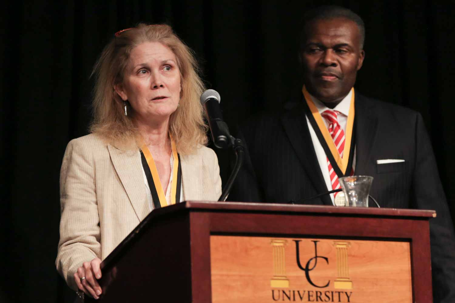 Sandy Rosenbush, an ESPN event news editor, accepts an honor medal on behalf of the Sports Journalism Institute, along with Leon Carter. The two are co-directors of the Institute, a nine-week training and internship program for college students interested in sports journalism careers. The Institute is designed to attract talented minorities and women to journalism through opportunities in sports reporting and editing as well as enhance racial and gender diversity in sports departments nationwide.