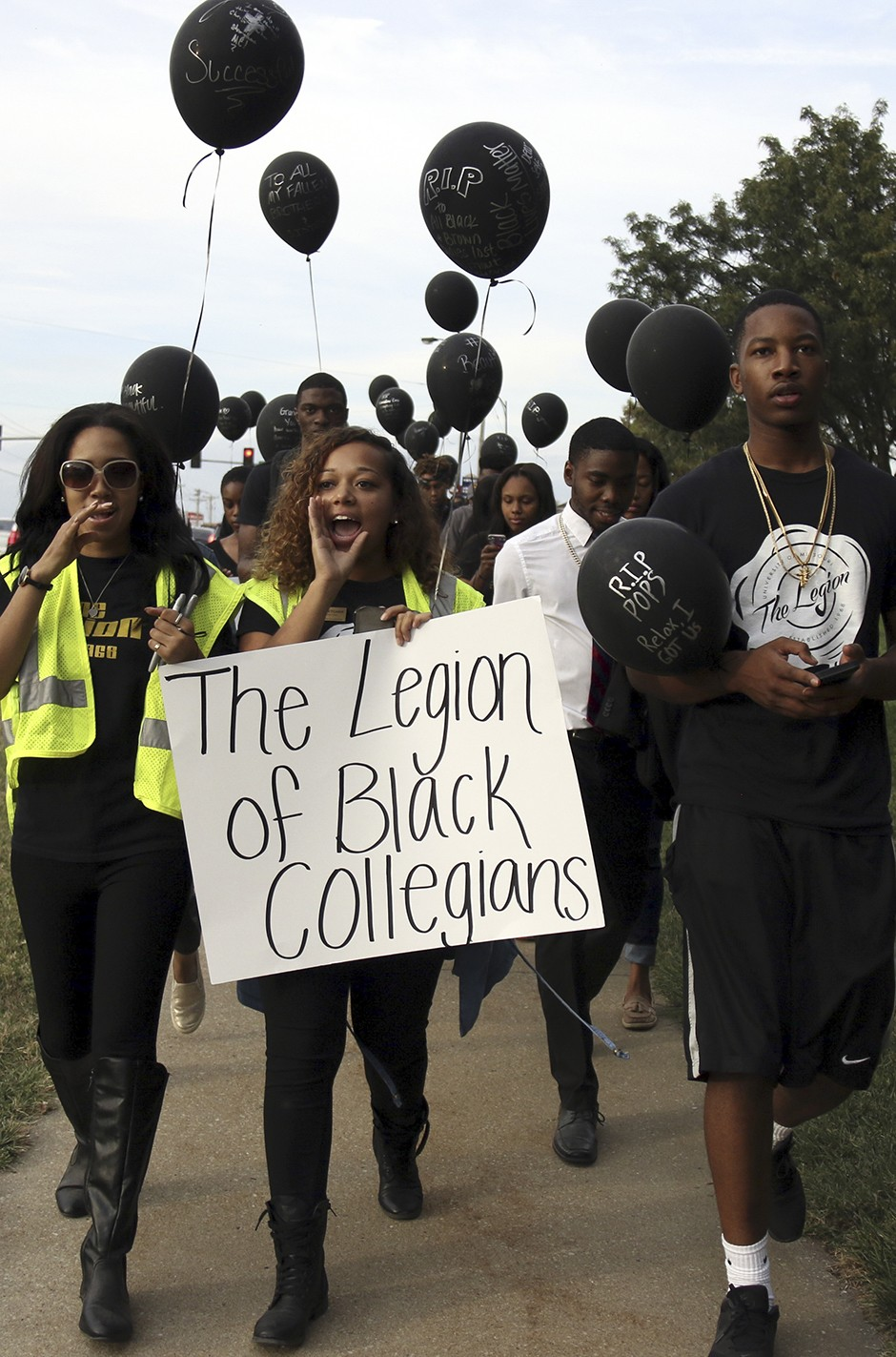 Legion of Black Collegians marching down the street.