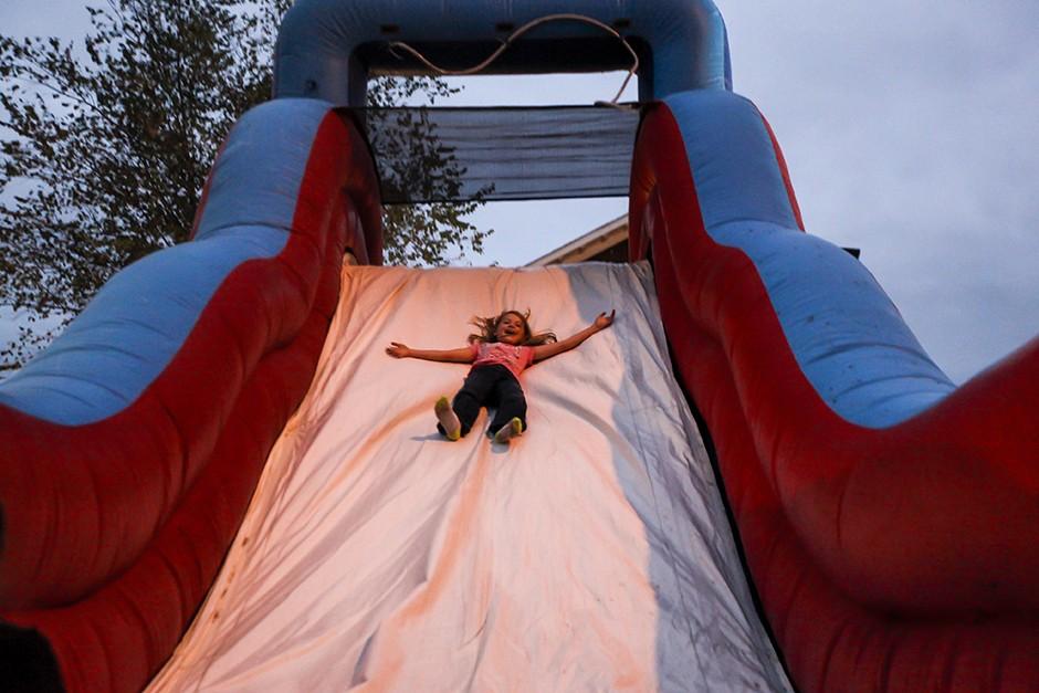 kid slides down slide