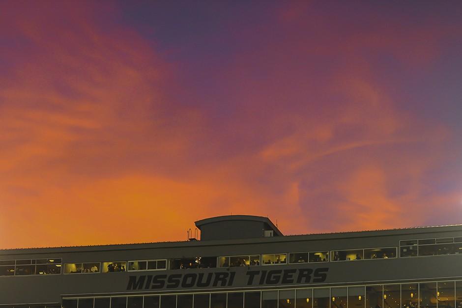 The sun sets over Memorial Stadium