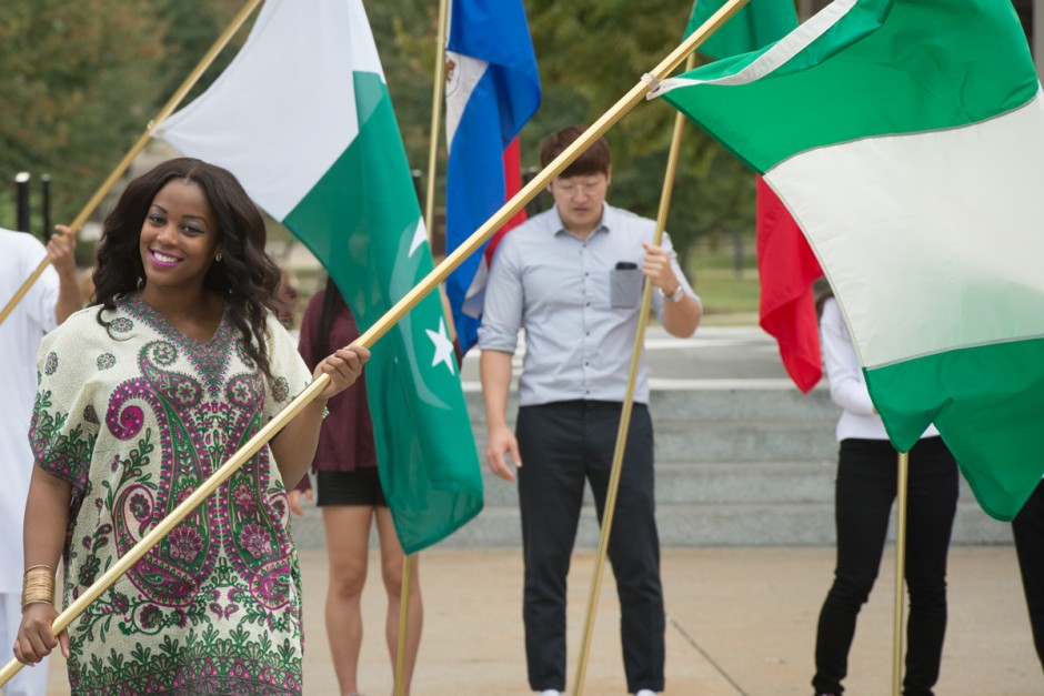 Nigerian student carrying flag.