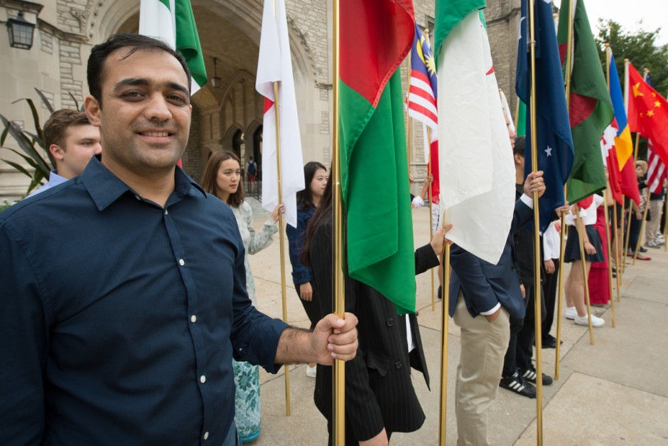 Smiling student with many flags.