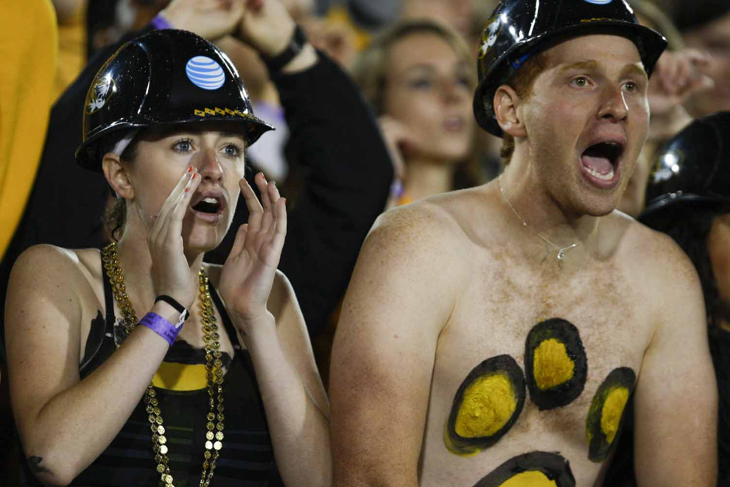 Taylor Lower, left, and Ryan Levi, right, cheer for the Tigers during the beginning of the first quarter of the Mizzou vs. Mississippi State game, Thursday evening. The two sat front row in Tiger's Lair. Photo by Tanzi Propst.