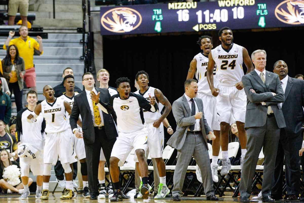The rest of the Mizzou men's basketball team cheers with coaches on the bench after scoring against the Wofford Terriers, Friday at Mizzou Arena.