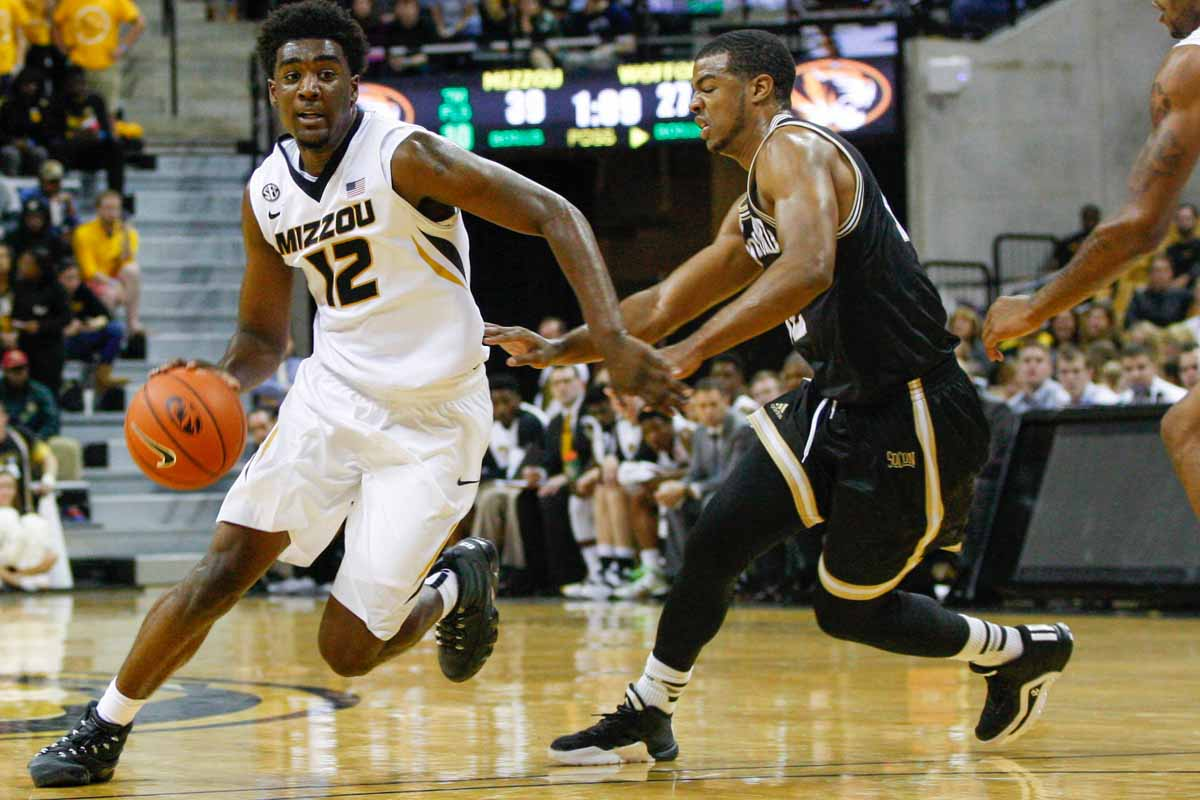 Namon Wright (12) runs ahead of Spencer Collins and presses towards the basket in an attempt to score against the Terriers Friday at Mizzou Arena.