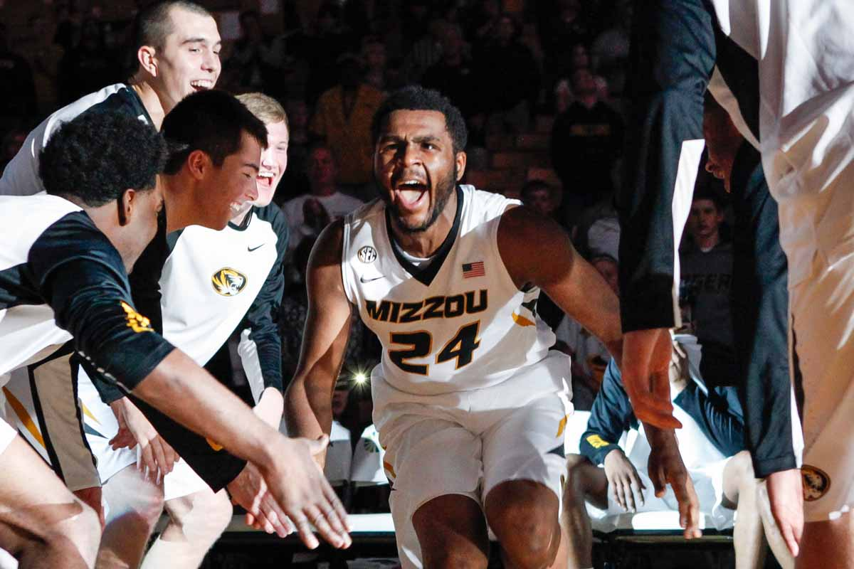 Kevin Puryear (24) gets fired up as he high-fives his teammates and runs onto the court after being announced as the starting forward for the Tigers Friday at Mizzou Arena during the game against the Wofford Terriers.
