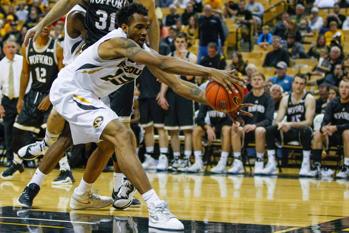 Jakeenan Gant (23) reaches to save the ball from flying out of bounds during the second half of the game against the Wofford Terriers Friday at Mizzou Arena.