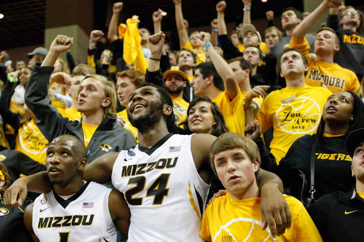 Terrence Phillips (1) and Kevin Puryear (24) sing Mizzou's alma mater with members of Zou Crew following their 83-74 win against the Wofford Terriers Friday at Mizzou Arena.