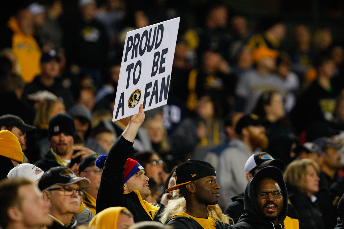 "A Tiger fan holds up a homemade sign reading ""Proud to be a fan"" during the second half. Photo by Tanzi Propst."