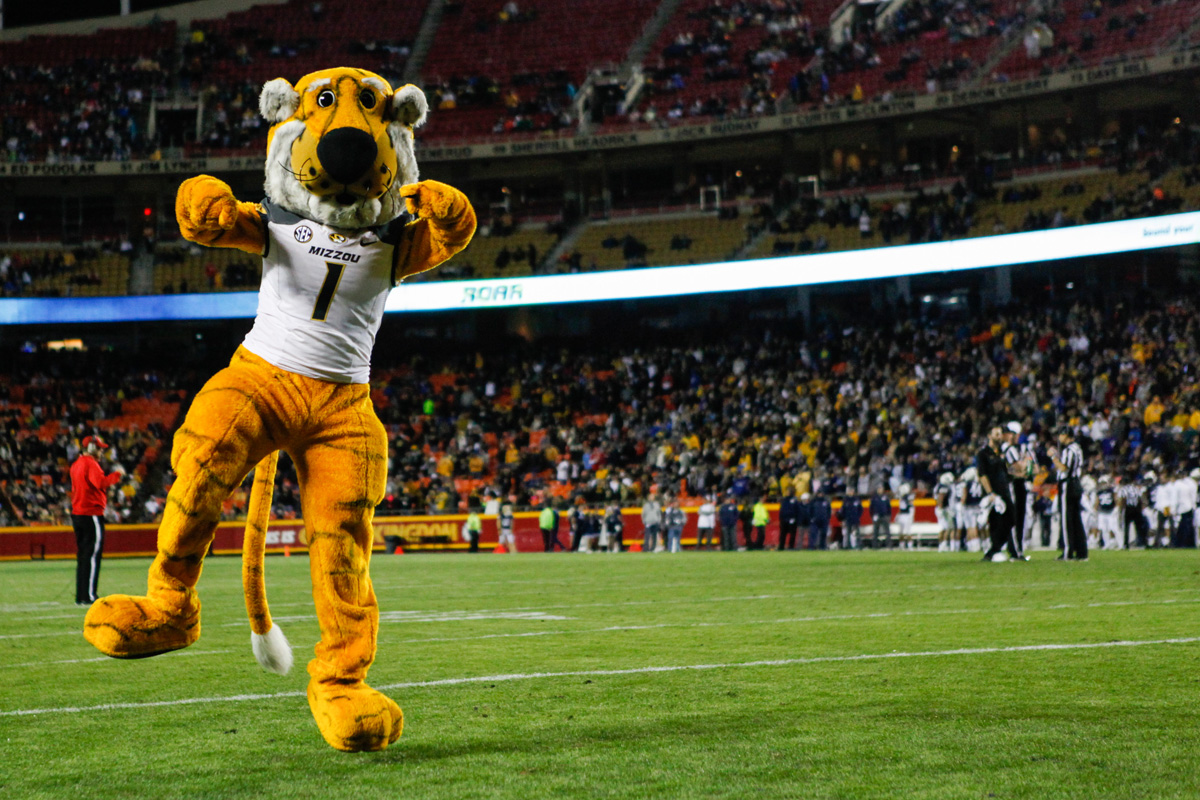 Truman the Tiger skips across the endzone pointing to fans after doing pushups for another Mizzou touchdown. Photo by Tanzi Propst.