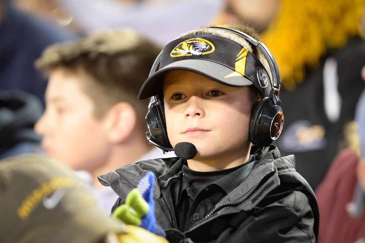 Lil' Pinkel, aka Nevin Hayes, 8, enjoys the game from a near front-row seat. Photo by Shane Epping.