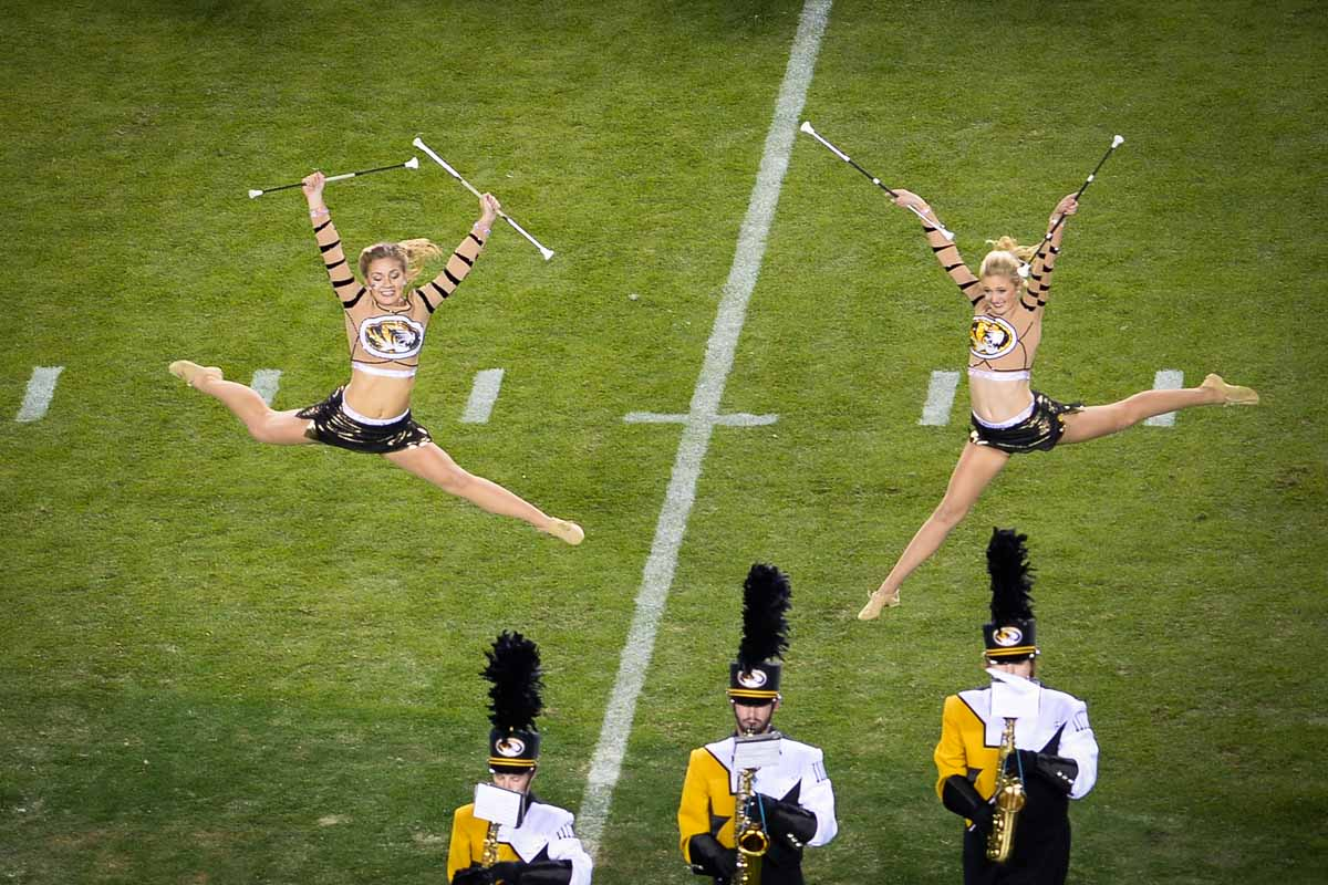 Twirlers Halie Hart and Lindsey McCormick show off their amazing skills and perform at halftime. Photo by Shane Epping.
