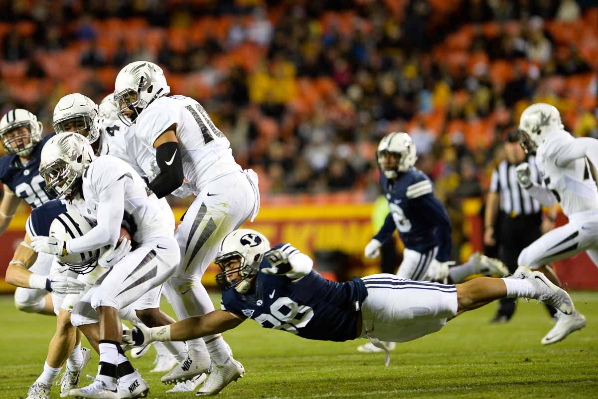 Freshman BYU linebacker Butch Pau'u fails to bring down the Tigers' offense. Photo by Shane Epping.
